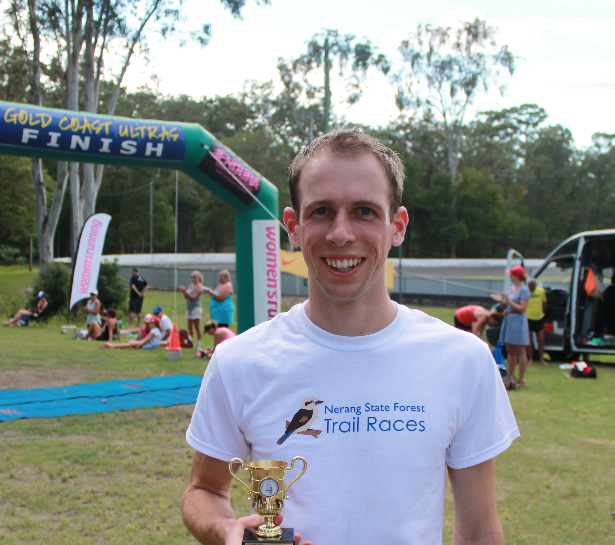 Shaun Clark running race finish - ashburton physiotherapist
